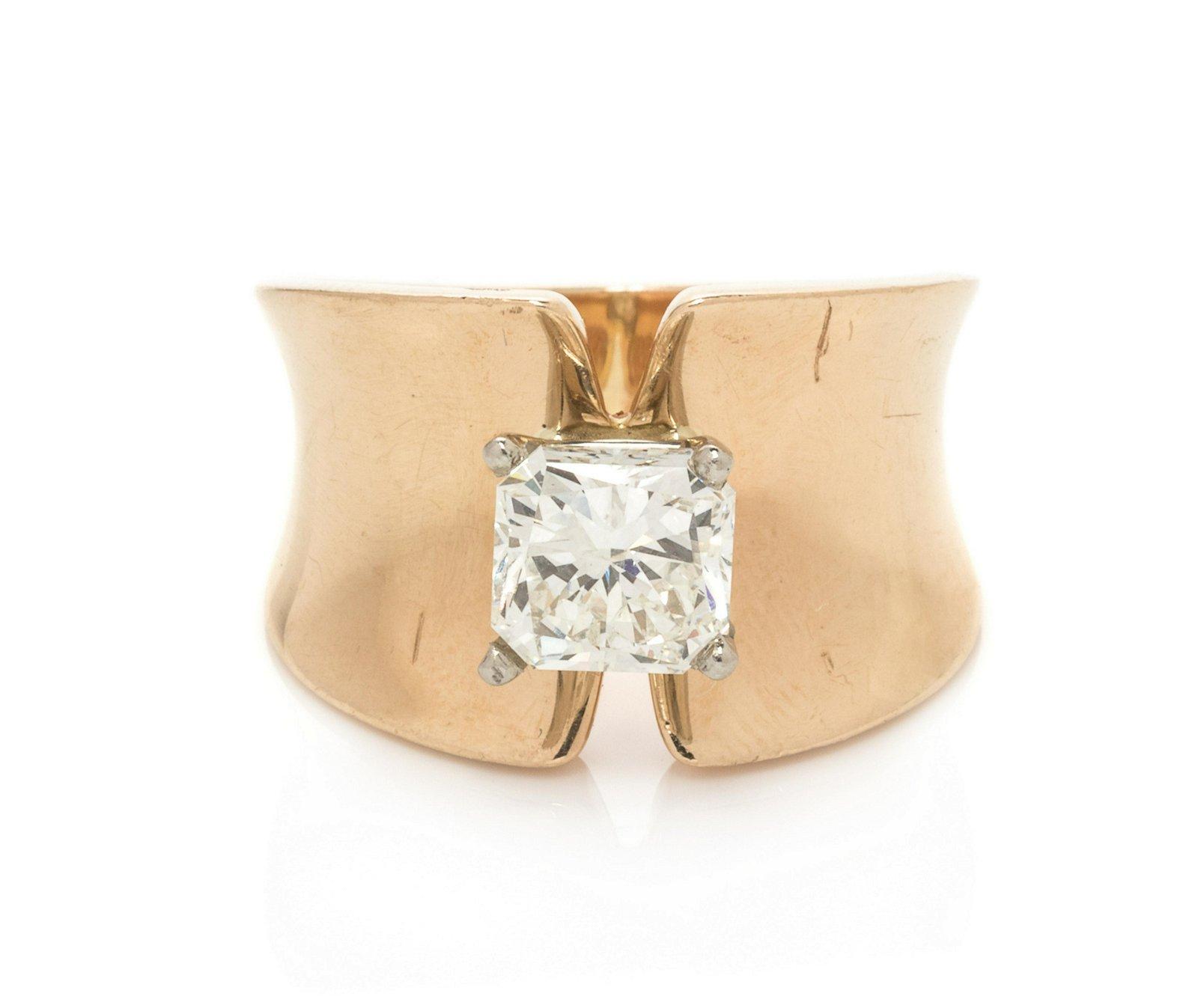 A 14 Karat Yellow Gold and Diamond Ring,