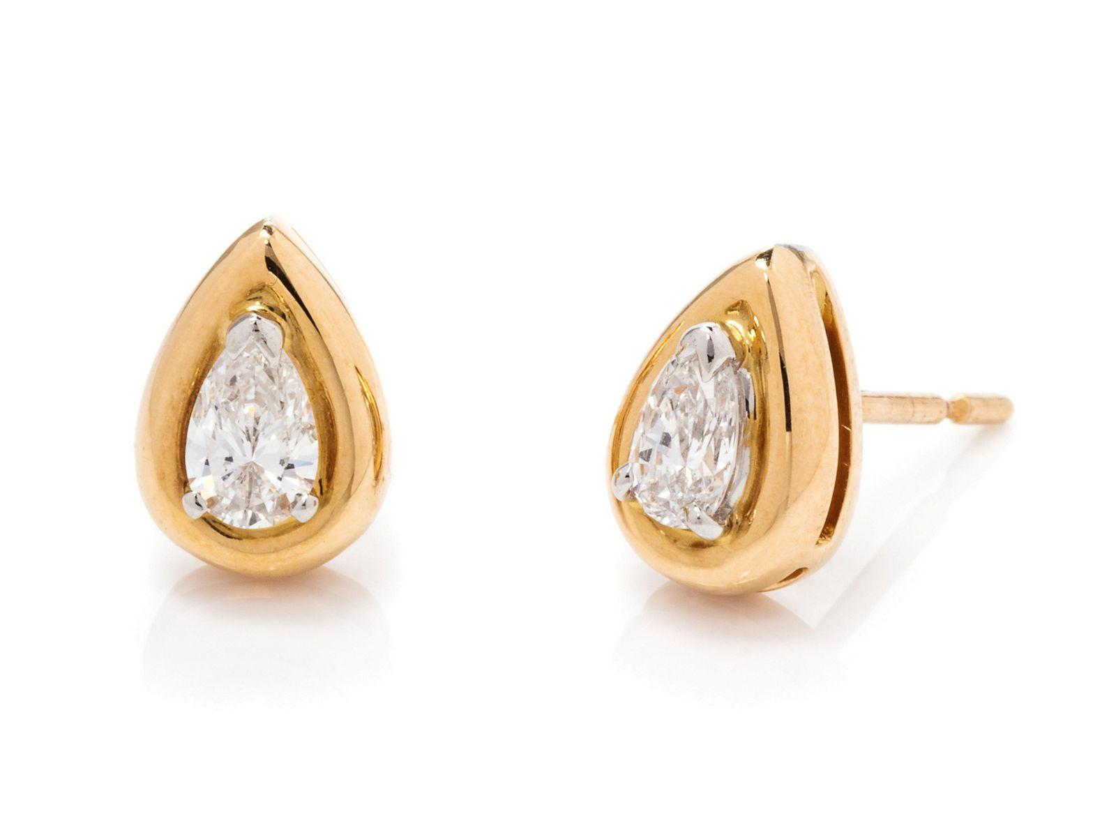 A Pair of 18 Karat Yellow Gold, Platinum and Diamond