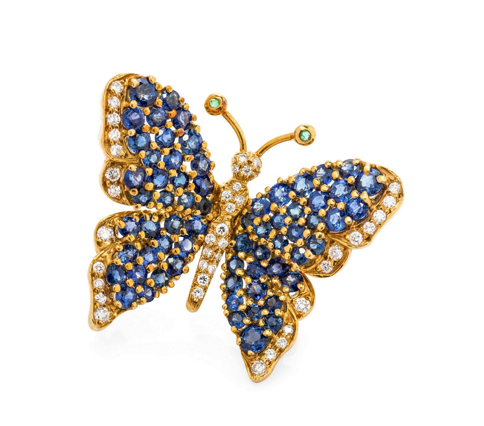 An 18 Karat Yellow Gold, Diamond, Sapphire and Emerald