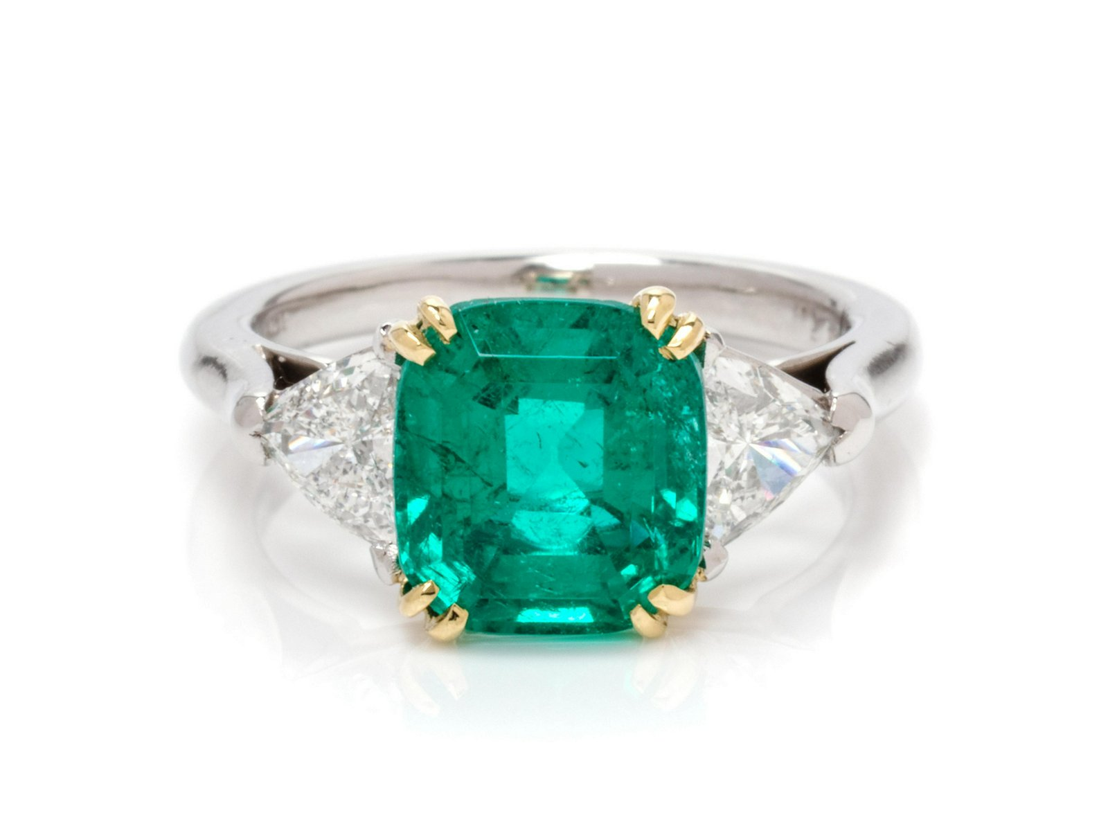 A Platinum, Yellow Gold, Colombian Emerald and Diamond