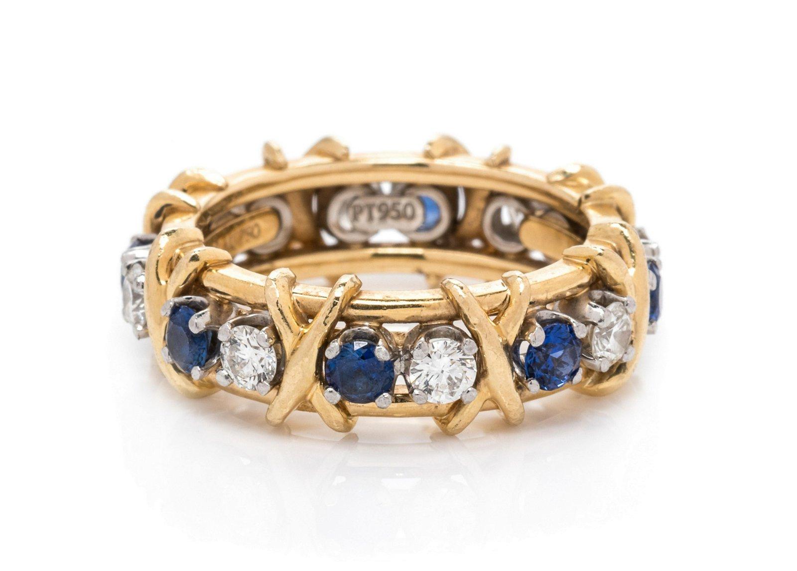 An 18 Karat Yellow Gold, Platinum, Diamond and Sapphire