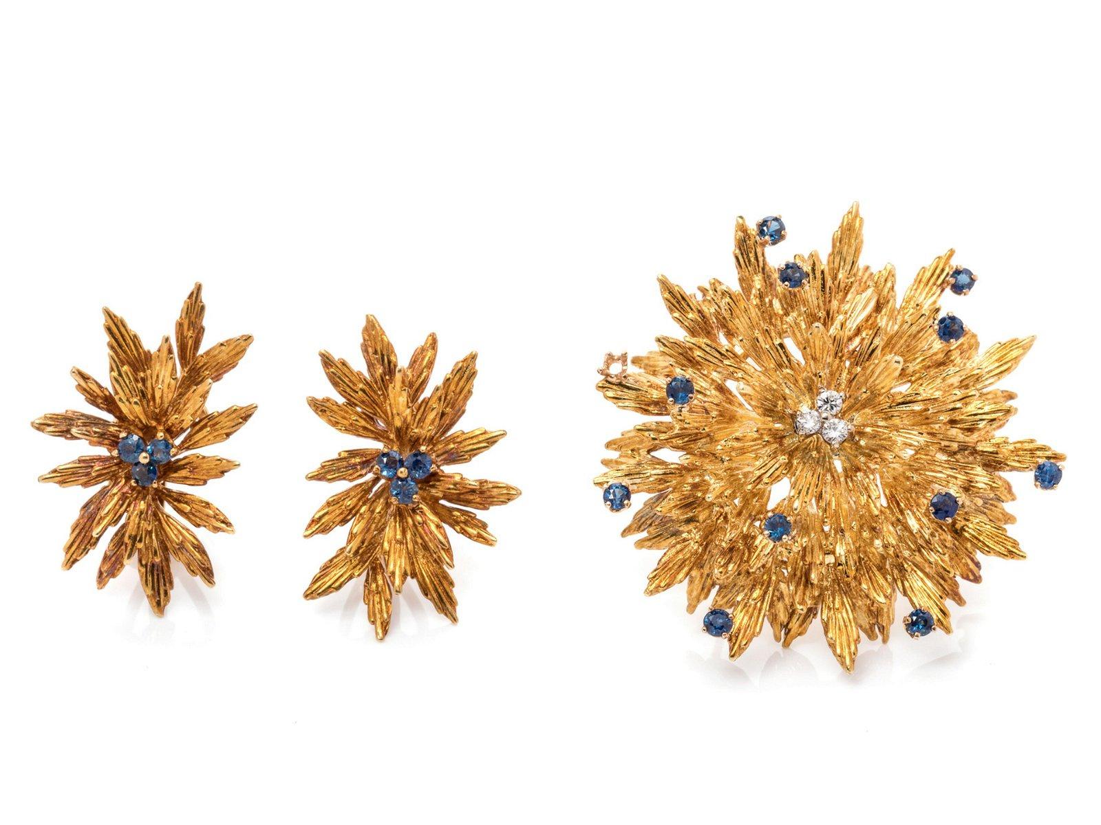 An 18 Karat Yellow Gold, Diamond and Sapphire