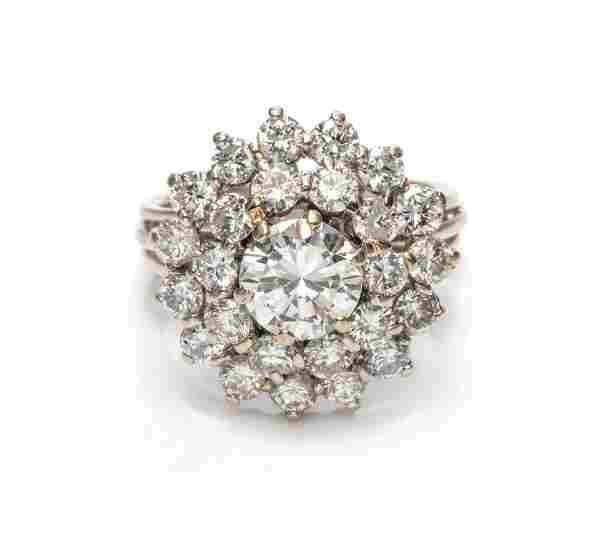An 18 Karat White Gold and Diamond Cluster Ring,
