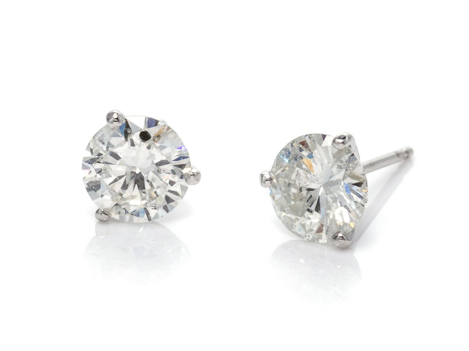 A Pair of 14 Karat White Gold and Diamond Stud