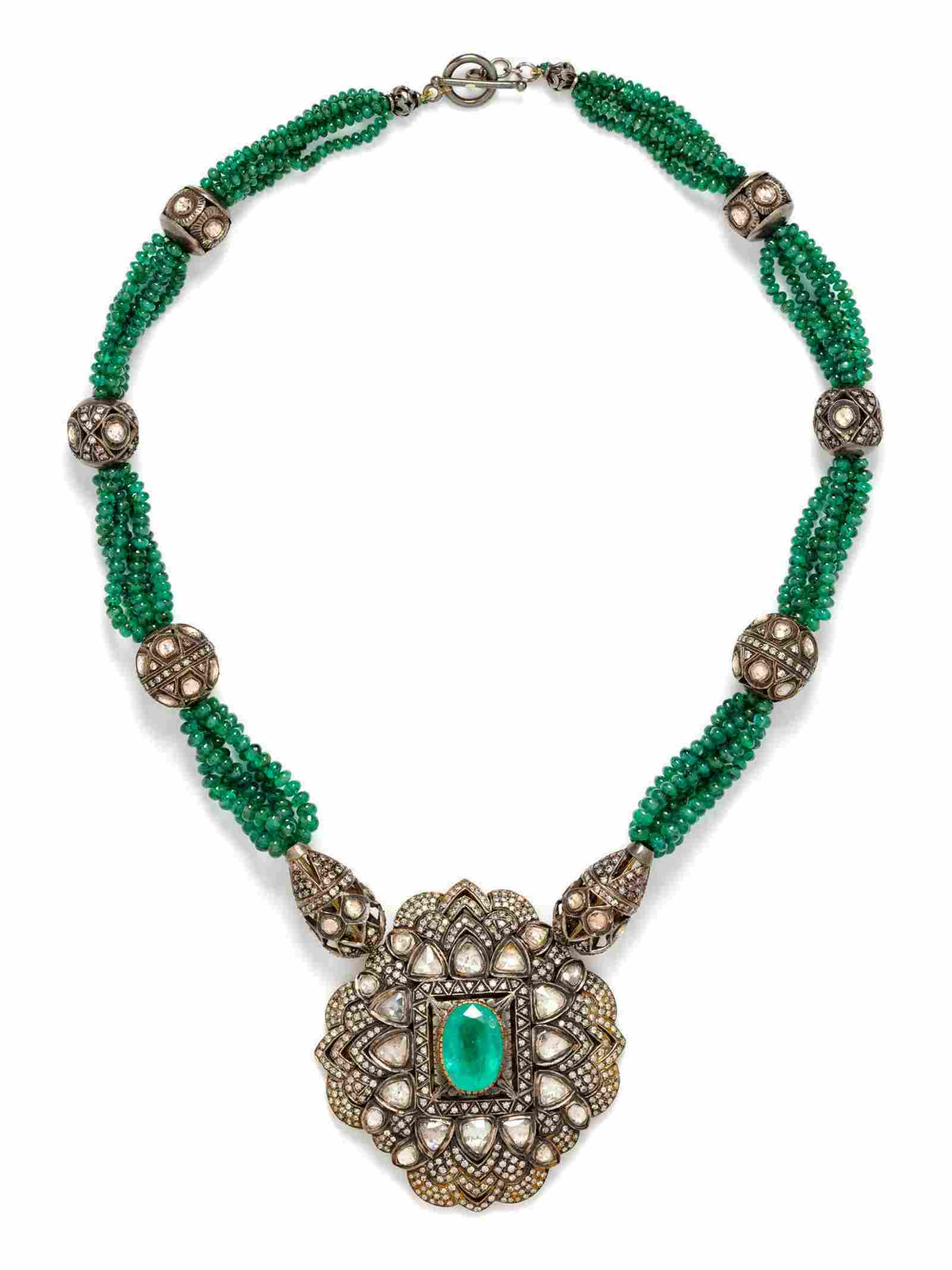 A Silver Topped Gold, Diamond and Emerald Bead