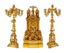 A French Gothic Revival Gilt Bronze Three-Piece Clock