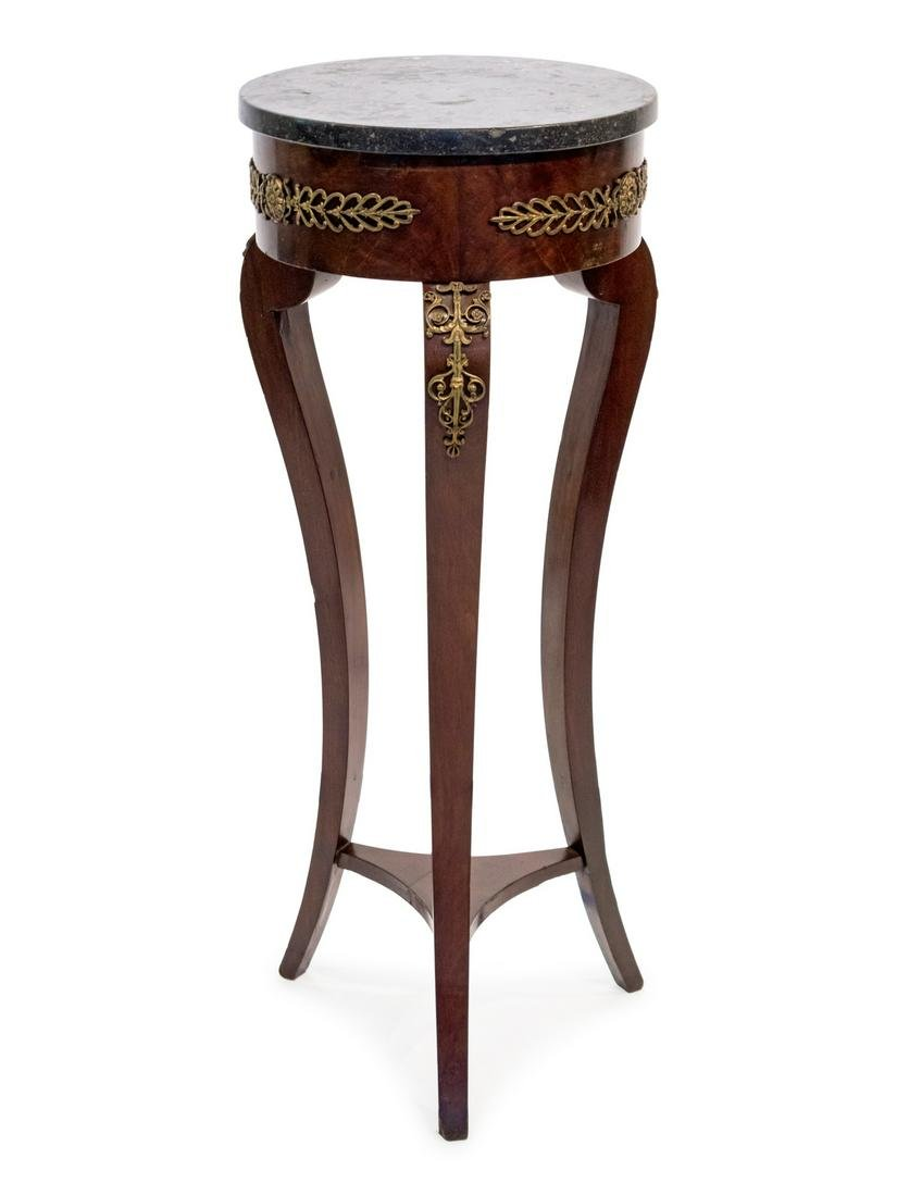 An Empire Style Gilt-Metal-Mounted Mahogany Pedestal