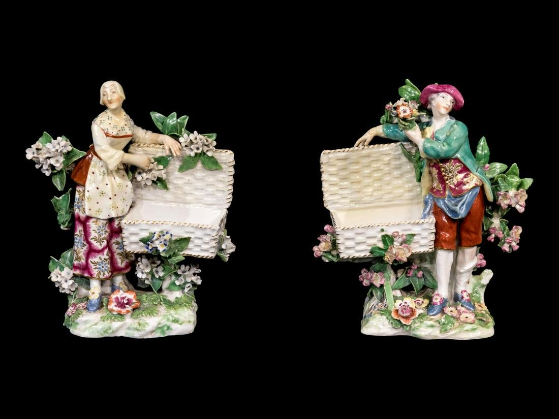 A Pair of Chelsea Porcelain Sweetmeat Figures