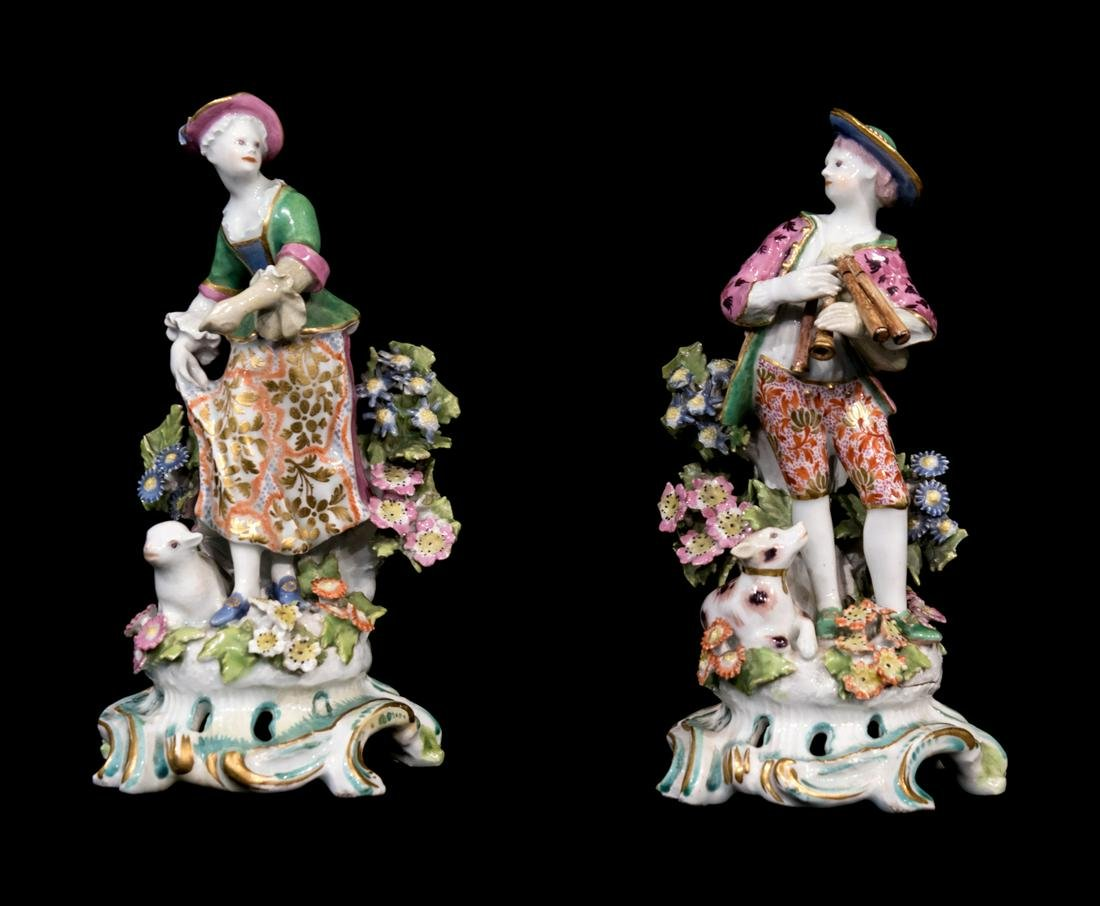 A Pair of Chelsea Porcelain Figures of a Boy and Girl