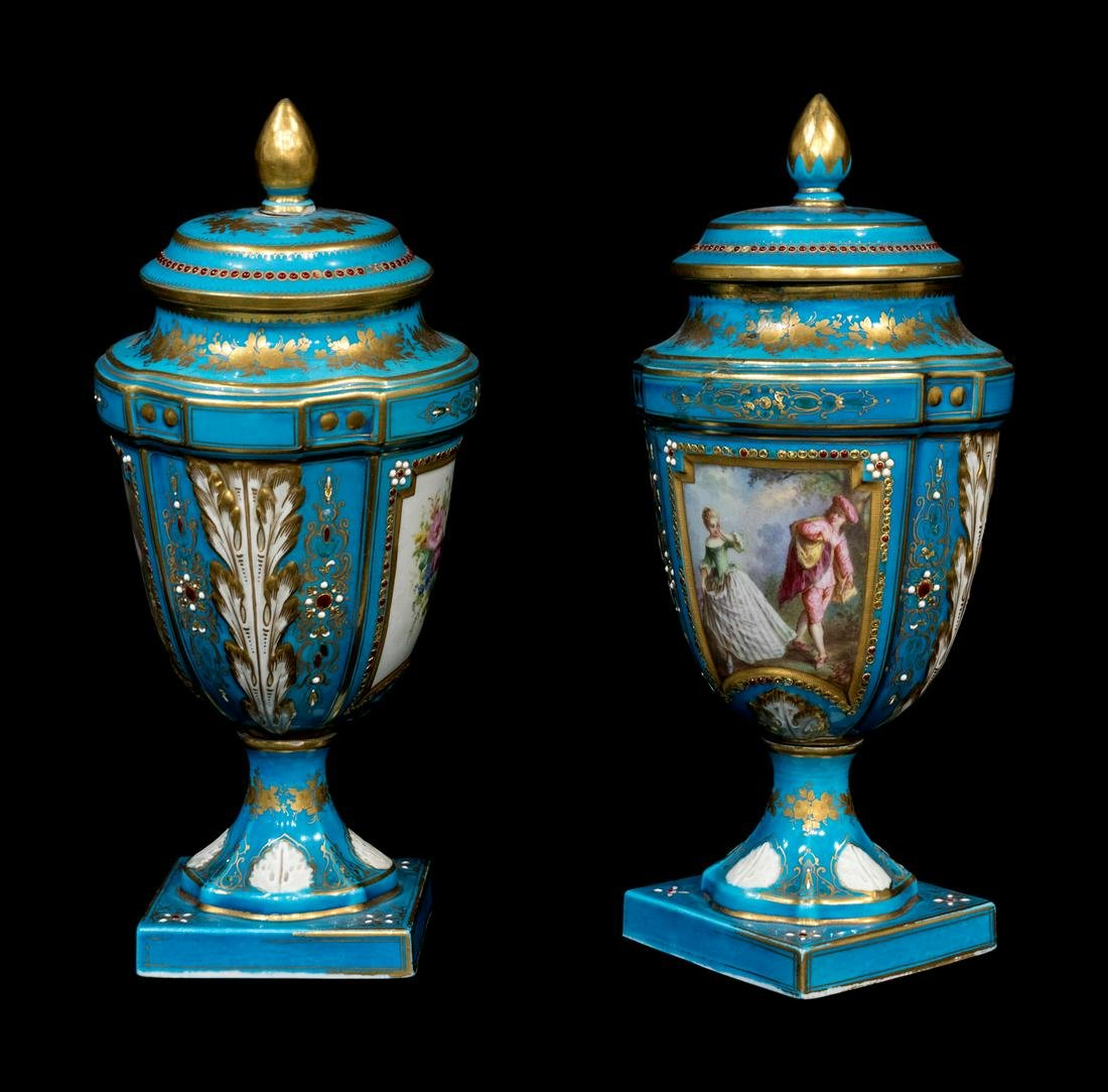 A Pair of 'Sevres' Porcelain Urns and Covers