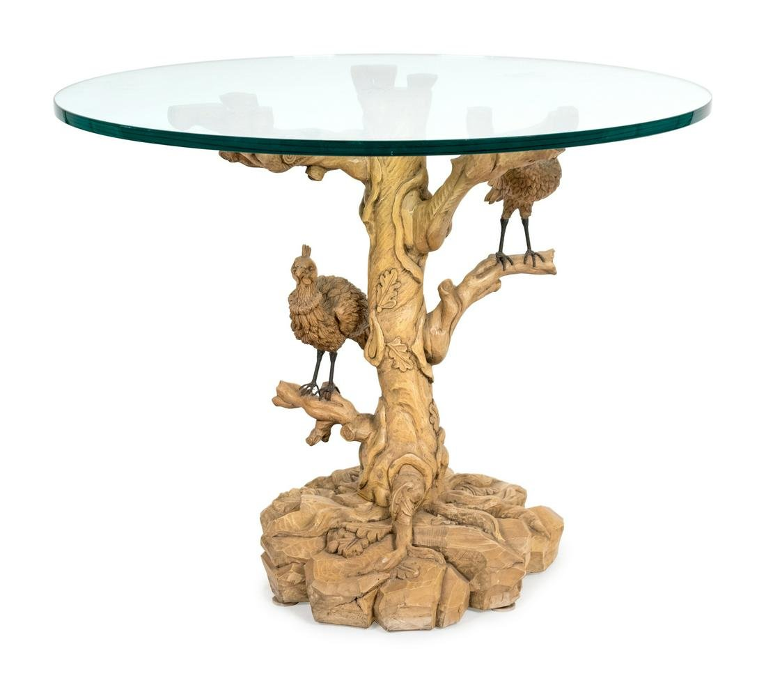 A Carved Wood Bird in Branch Pedestal Table