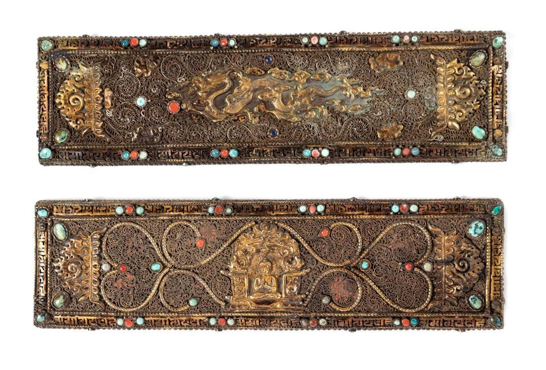 A Pair of Tibetan Parcel-Gilt and Silvered Manuscript