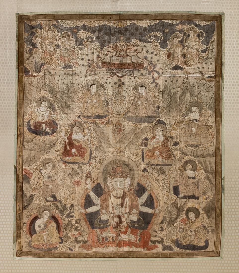 A Tibetan Silk and Metallic Thread-Embroidered Thangka