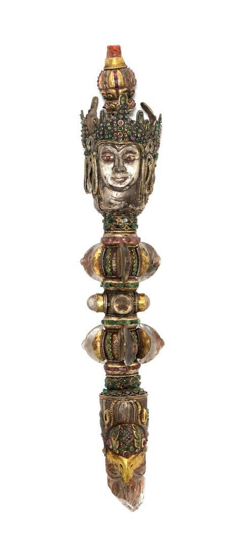 A Tibetan Silvered Metal and Quartz Ritual Phurba, and