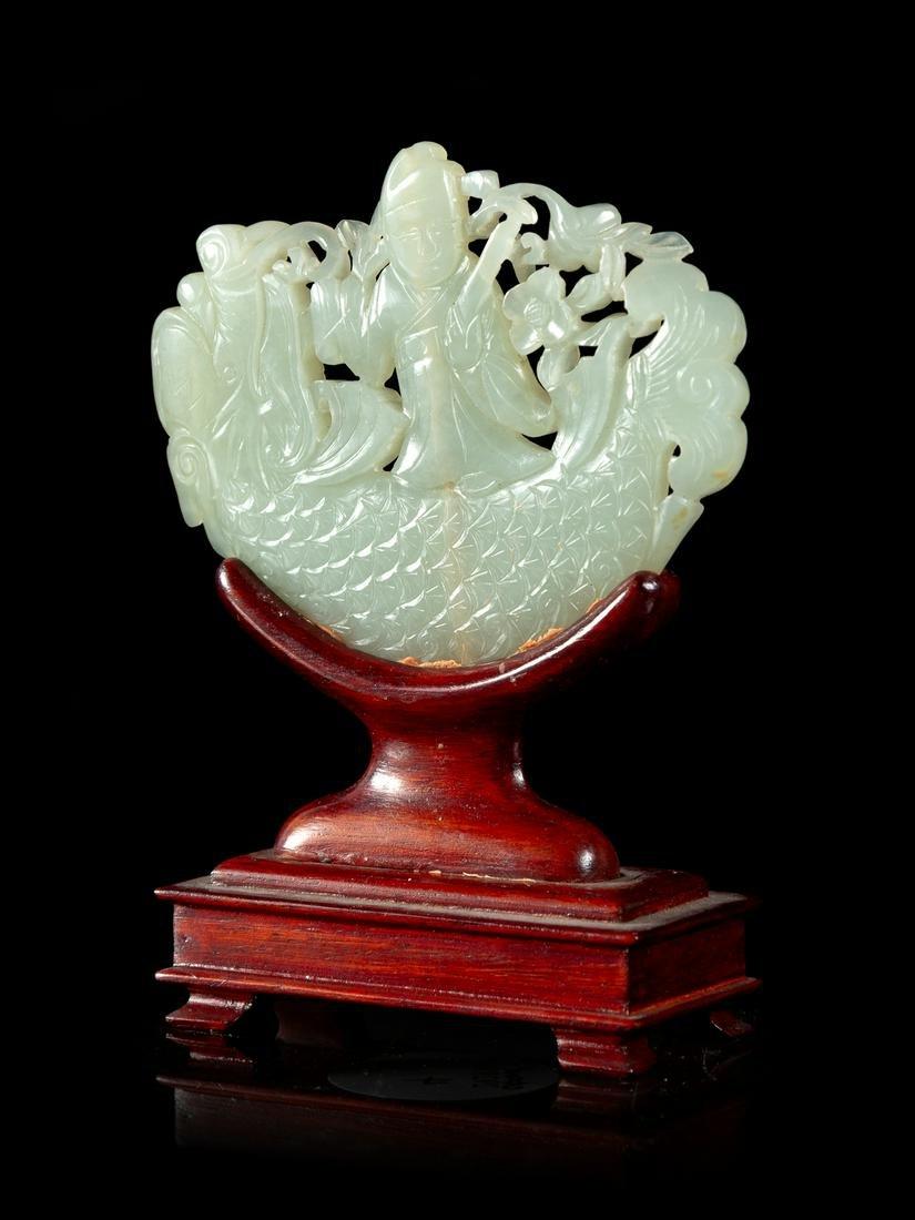 A Pale Celadon Jade Pendant Length 2 3/4 x height 2 1/4