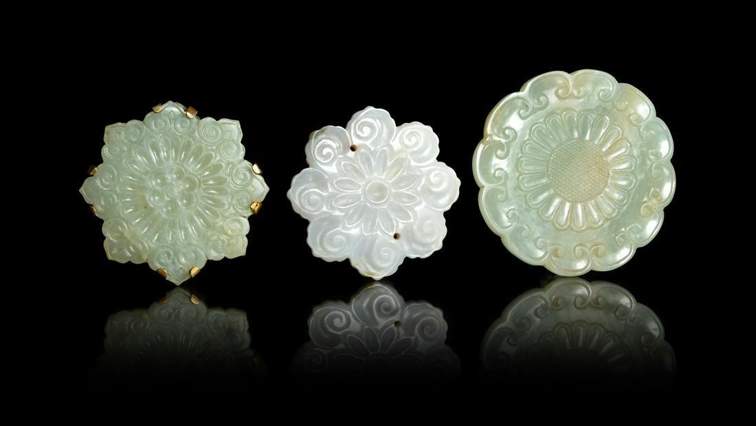 Three Celadon Jade Floriform Pendants Widest: width 2