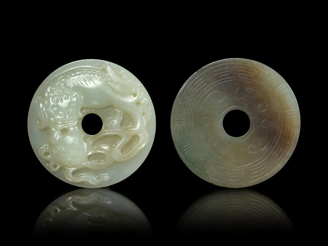 Two Jade Bi-Form Pendants Larger: diam 2 1/4 in., 6 cm.