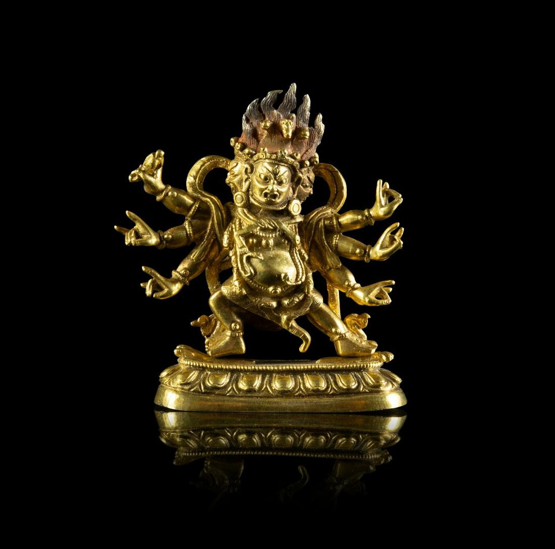 A Small Sino-Tibetan Gilt Bronze Figure of a Six-Armed