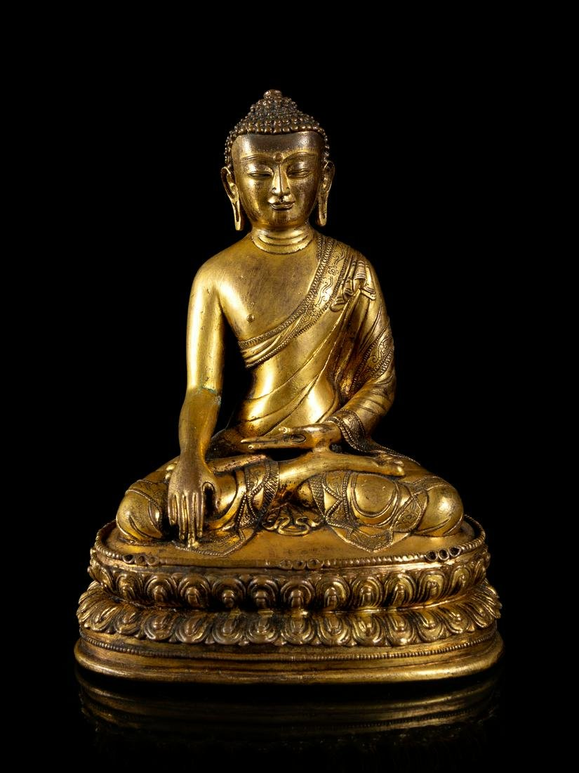 A Sino-Tibetan Gilt Bronze Figure of Buddha Height 7