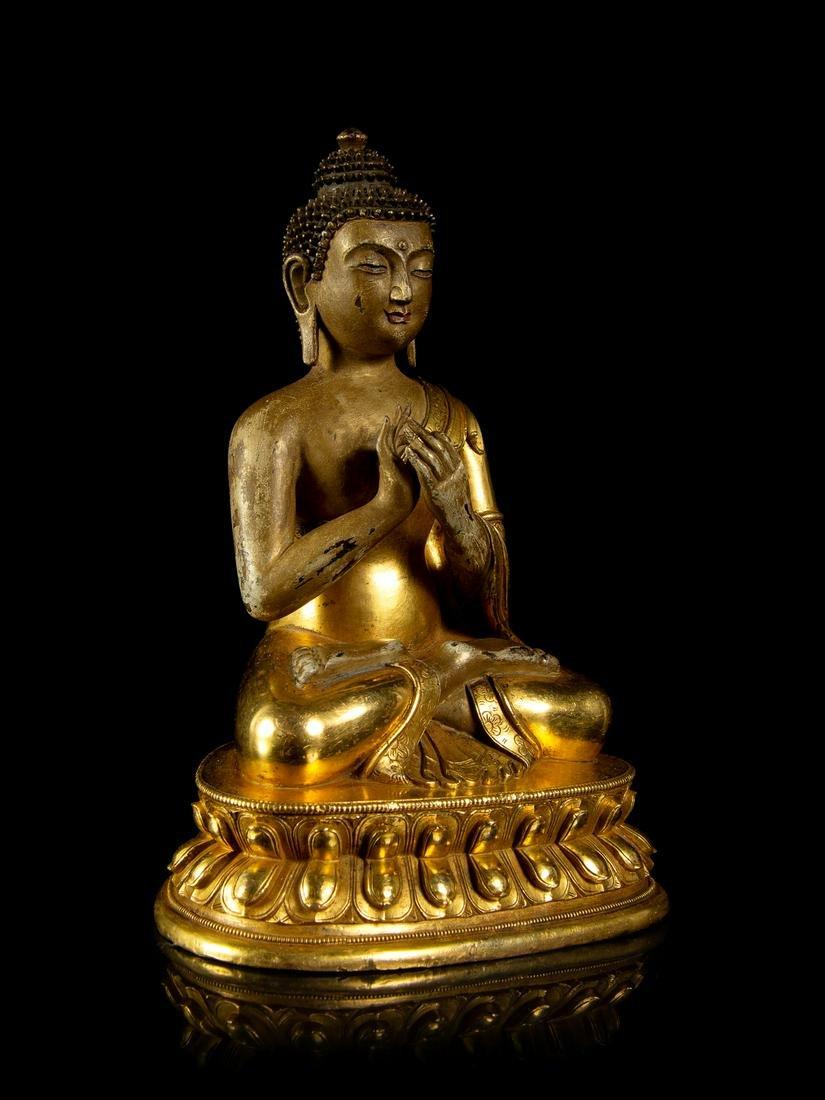 A Sino-Tibetan Gilt Bronze Figure of Buddha Height 6
