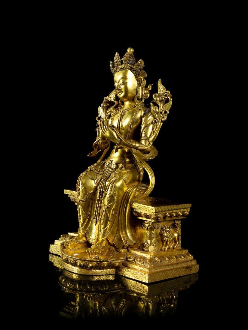 A Sino-Tibetan Gilt Bronze Figure of Maitreya