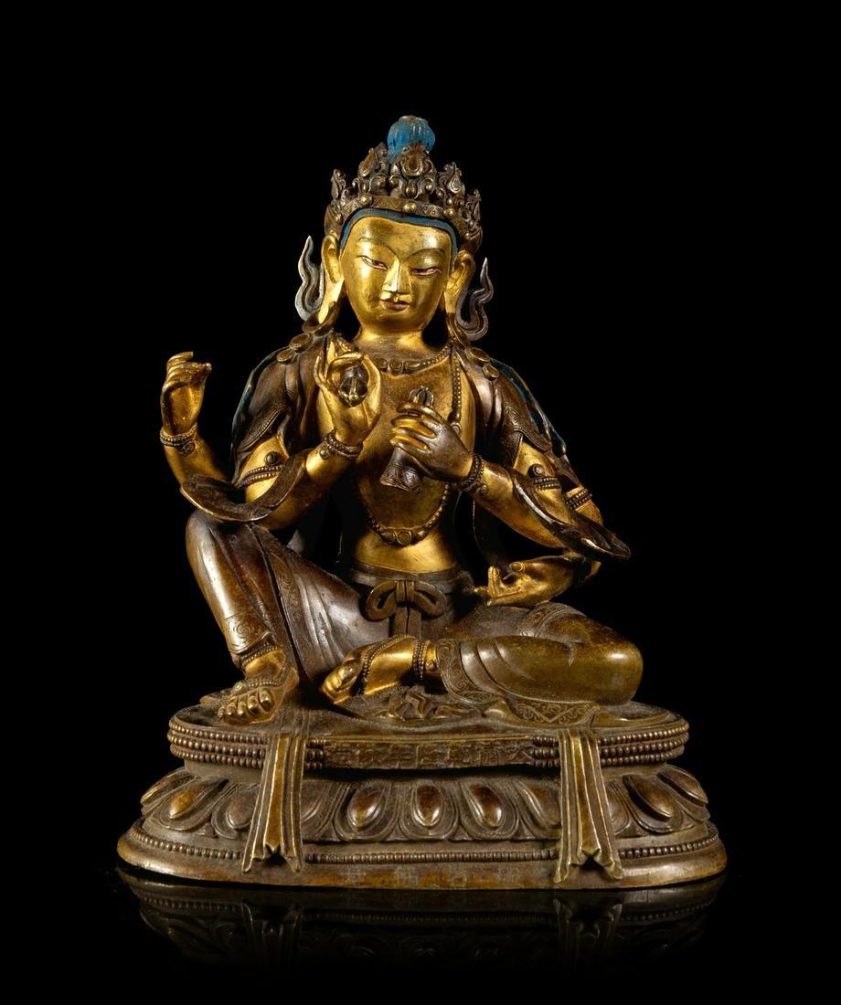 A Sino-Tibetan Gilt Bronze Figure of a Four-Armed