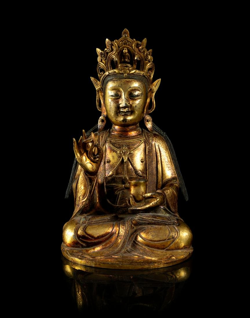 A Gilt Bronze Figure of Guanyin Height 10 1/4 in., 26