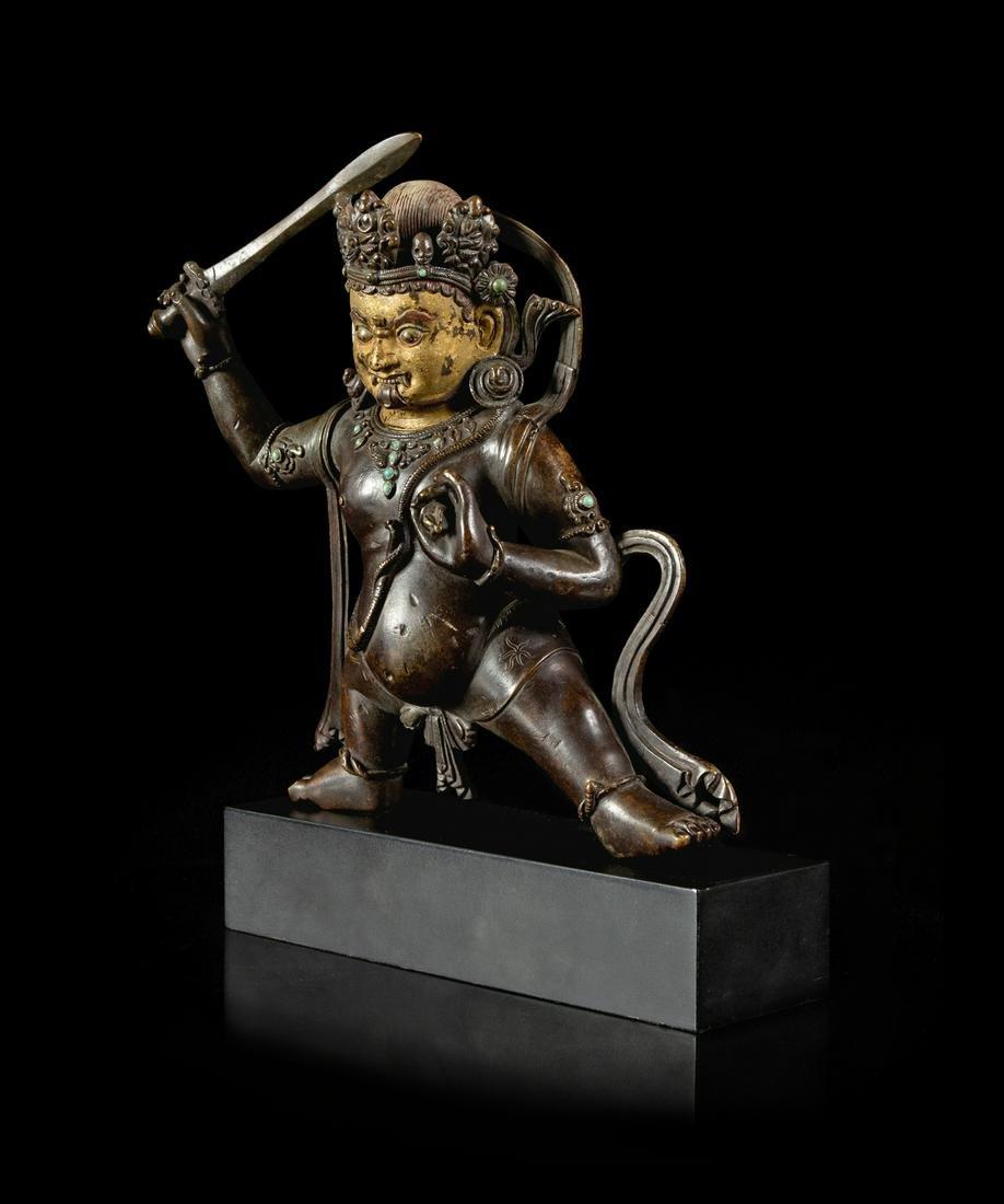 A Sino-Tibetan Parcel-Gilt Bronze Figure of Jambhala