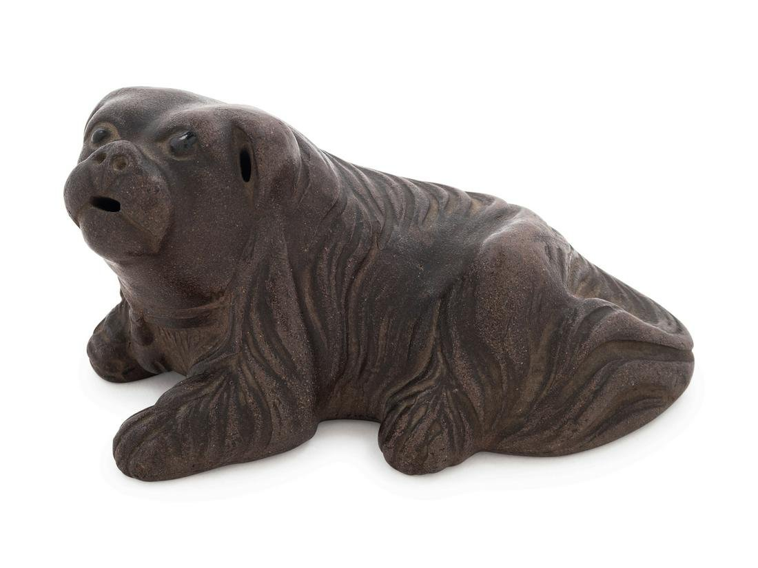 A Yixing Pottery Figure of a Recumbent Dog Length 4