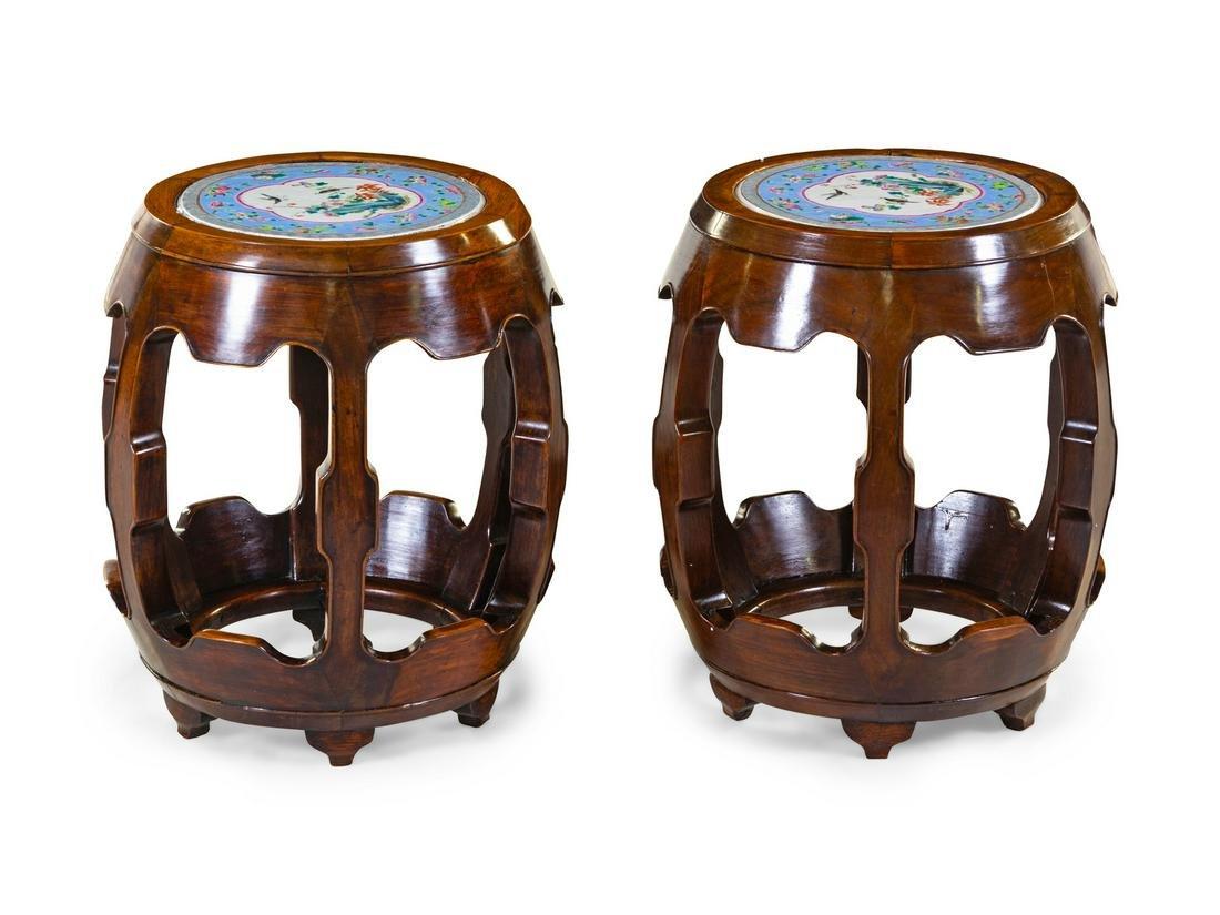 A Pair of Porcelain Plaque Inset Hardwood Garden Stools