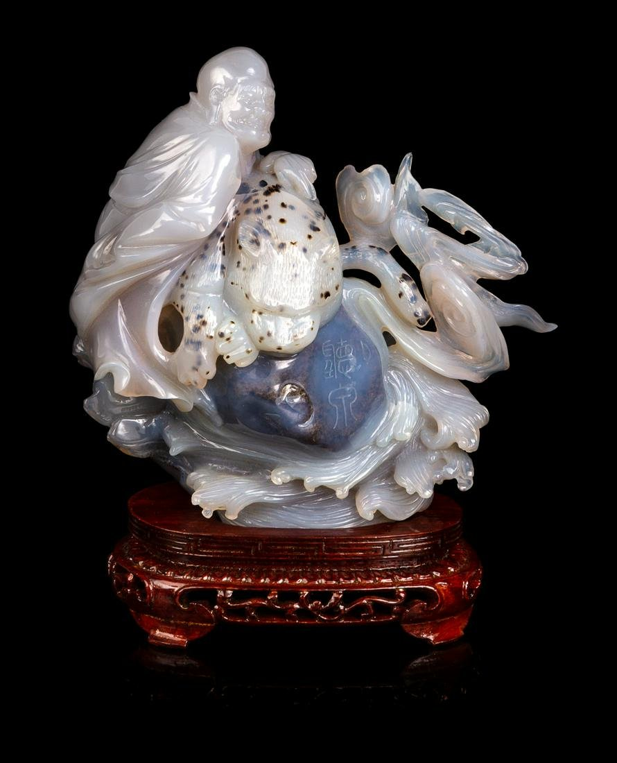 A Chinese Carved Agate Figural Group Height 5 3/4 in.,