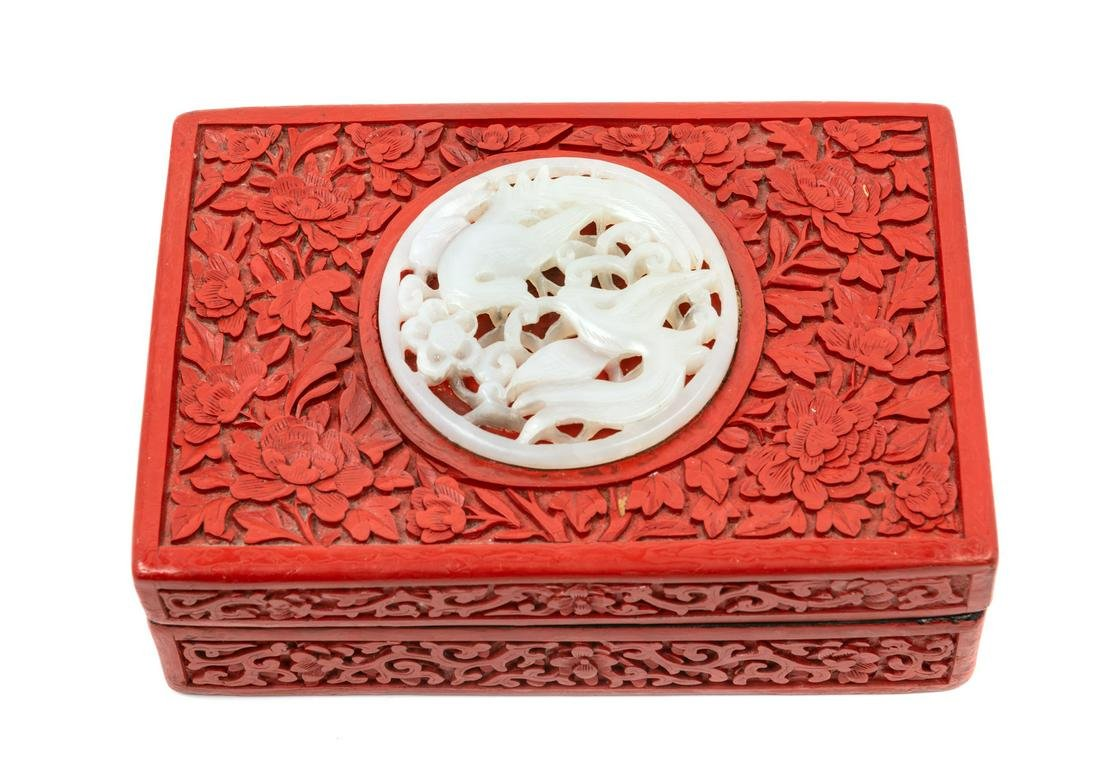 A Chinese Pale Celadon Jade Inset Carved Red Lacquer