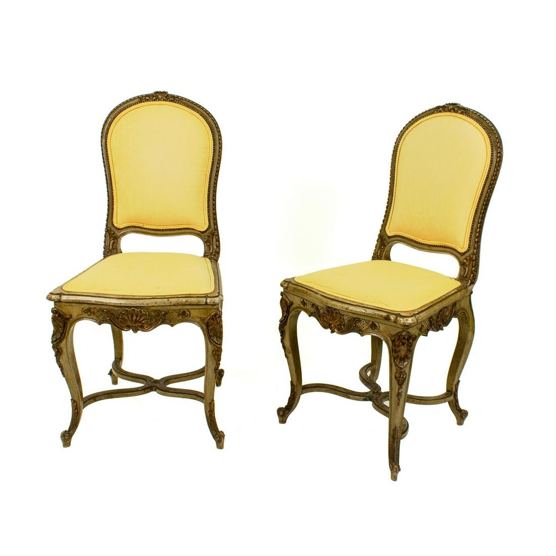A Pair of French Louis XV Style Painted and Parcel Gilt