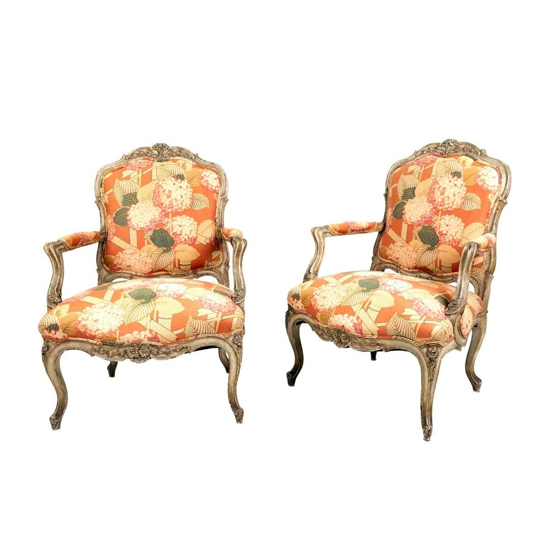 A Pair of Louis XV Style Carved and Painted Fauteuils
