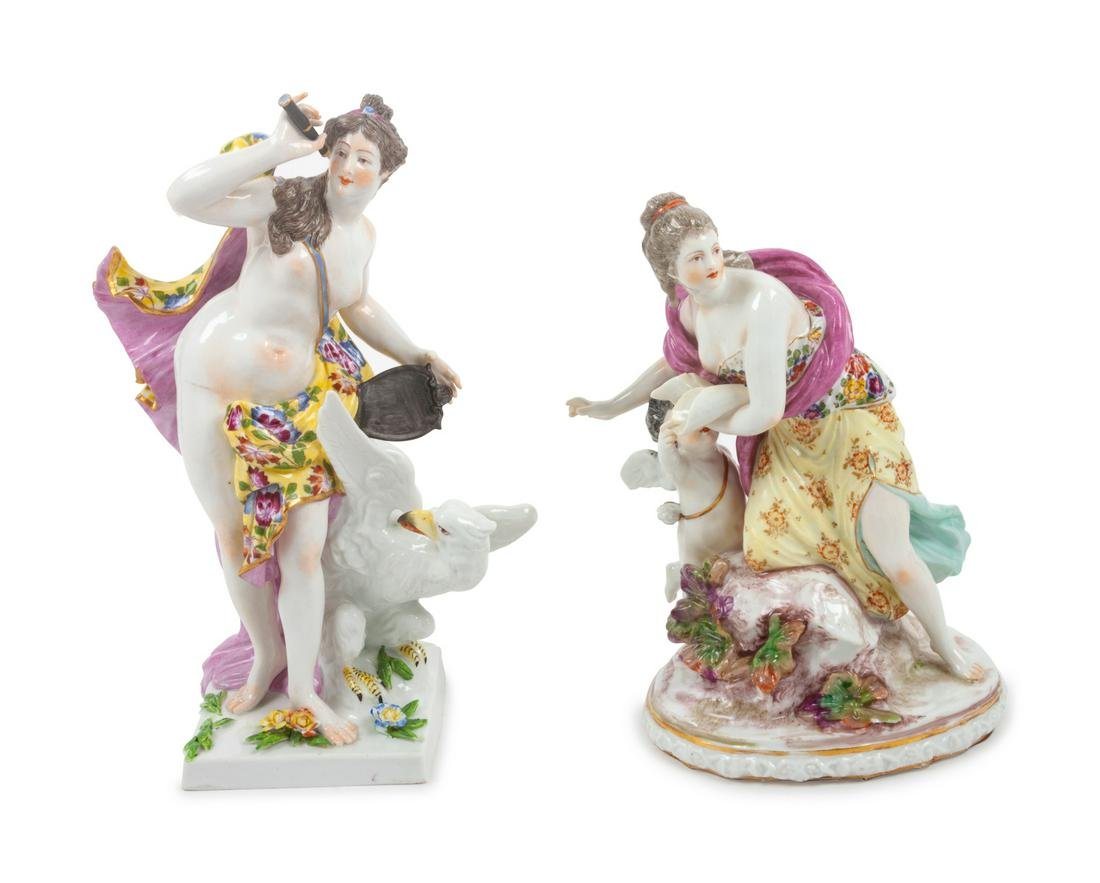 Two Continental Porcelain Figures Height 10 inches.