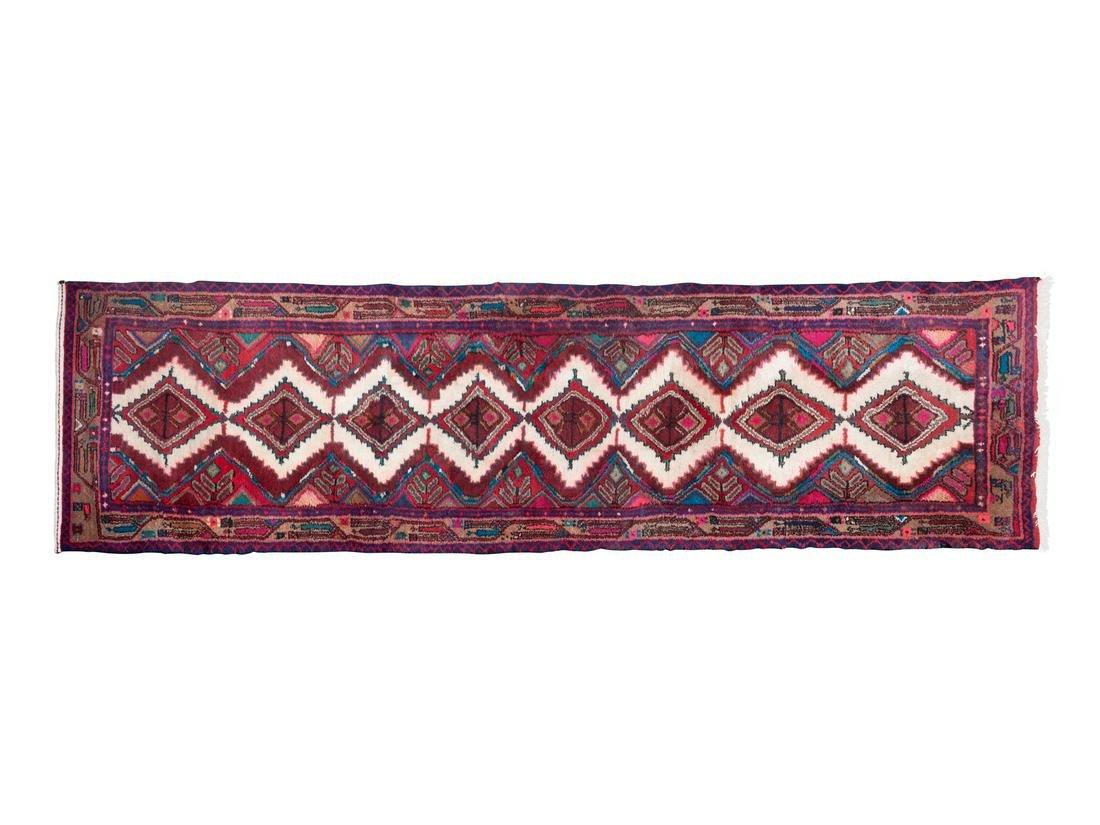 A Persian Wool Runner 9 feet 1 inch x 2 feet 6 inches.