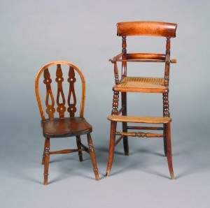 A Child's Windsor Style Oak Chair. Height 26 inches.