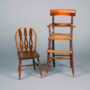7: A Child's Windsor Style Oak Chair. Height 26 inches.