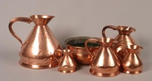 46: A Group of Five English Copper Pitchers, Height of