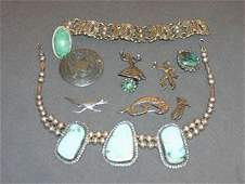 1208: A Collection of Three Sterling Silver Items,