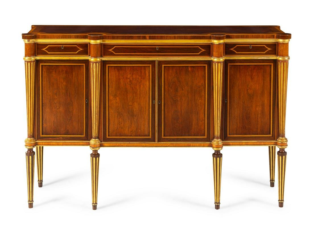 A Russian Neoclassical Parcel Gilt Cabinet