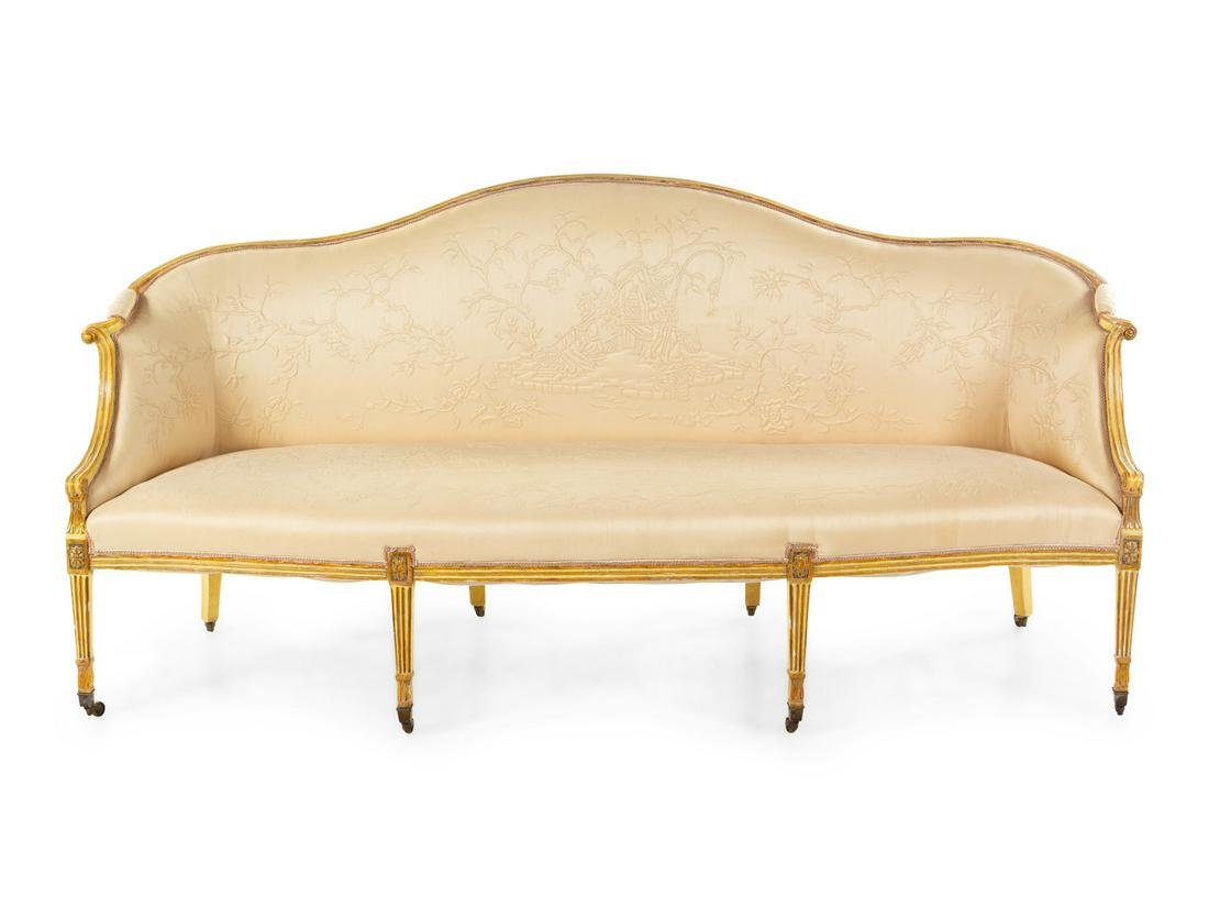 A George III Cream-Painted and Parcel Gilt Camelback