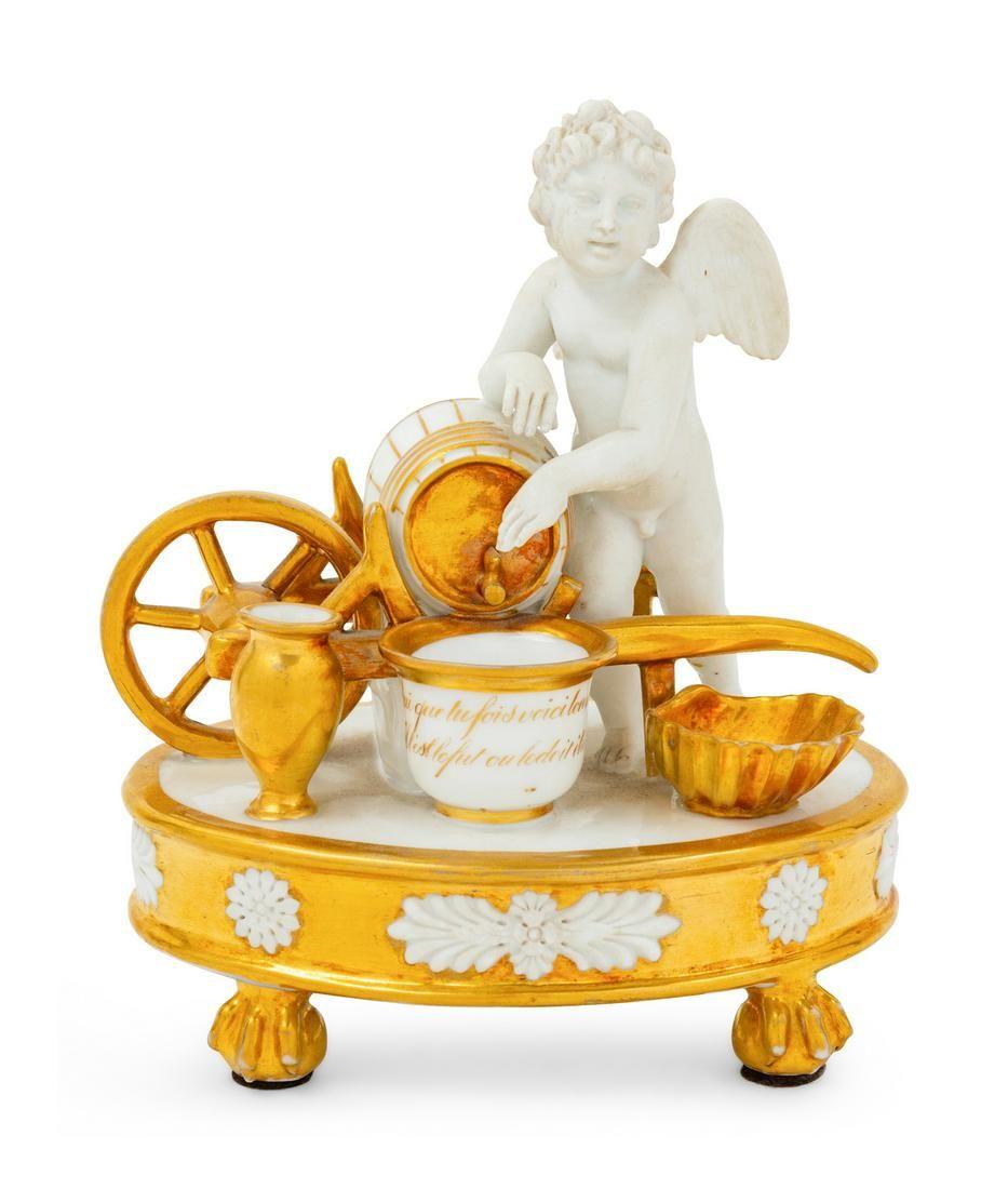 A Paris Porcelain Parcel Gilt Figural Encrier
