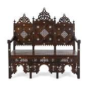 An Egyptian Carved and Inlaid Settee