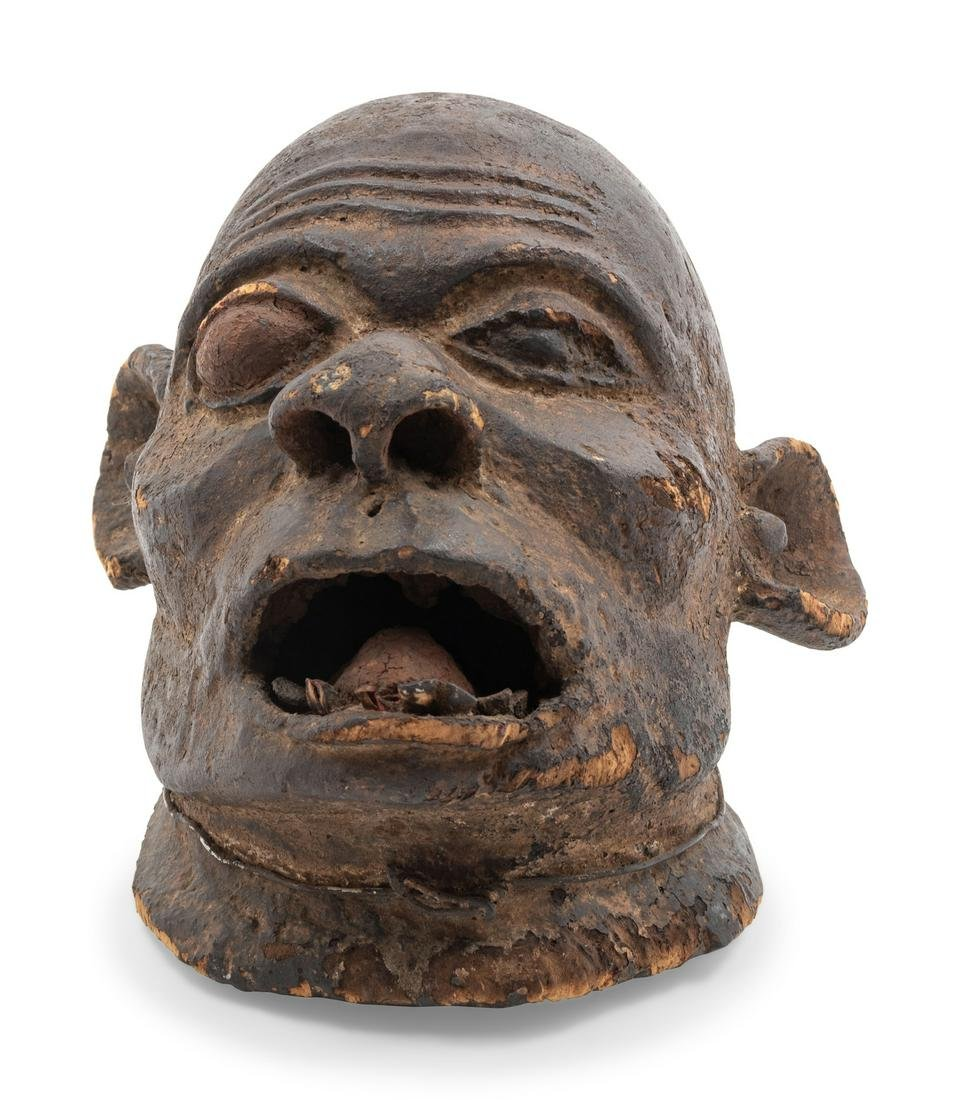 A Makonde Carved Wood Mask Height 14 inches.