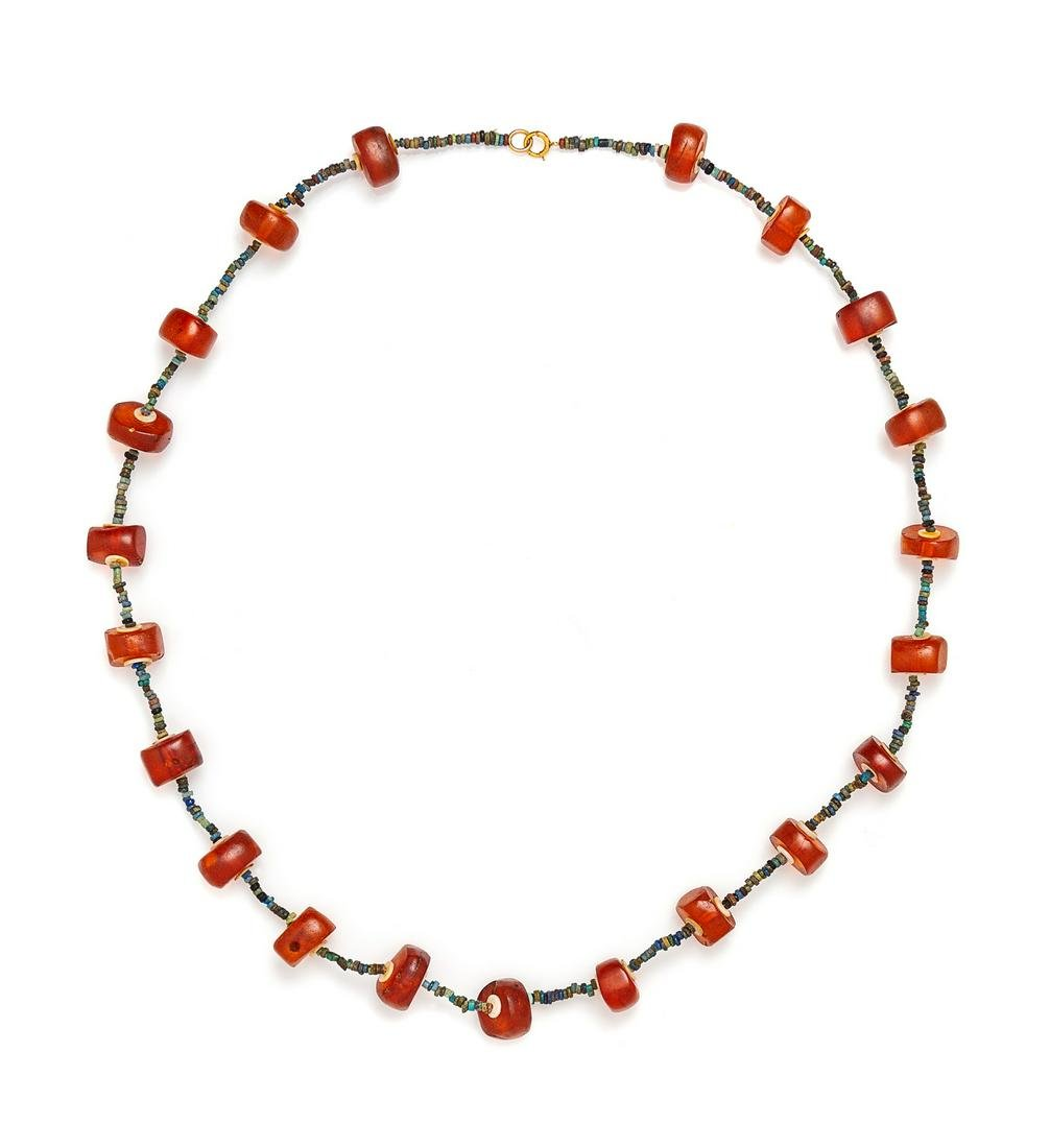 An Egyptian Amber and Faience Beaded Necklace