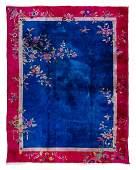 A Chinese Wool and Silk Rug 11 feet x 9 feet.