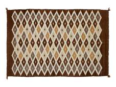 Group of Four Regional Navajo Rugs  largest 51 x 36