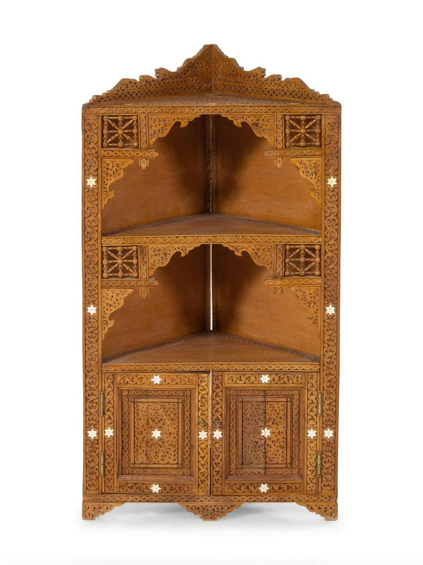 An Egyptian Carved and Inlaid Corner Cabinet