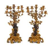 A Pair of French Gilt and Patinated Bronze EightLight